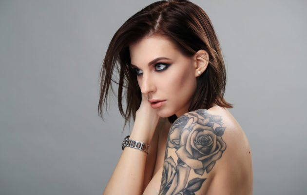 Beautiful woman with tattoo on a hand